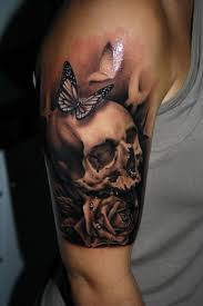 butterfly and skull on right half sleeve