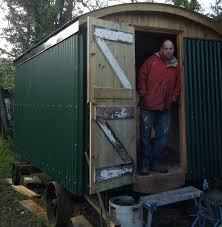 the fellowship of the shed installing a stove into a shed
