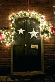front doors a jumbo wreath with jolly decorations christmas