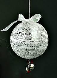 one dozen pretty paper ornaments you can make crafts