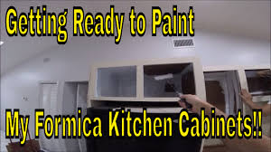 removing laminate from kitchen cabinets and painting getting ready to paint my formica kitchen cabinets remove cabinet hardware prime inside cabinets