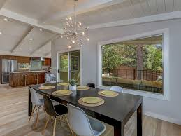 modern dining room with exposed beam u0026 cathedral ceiling in boise