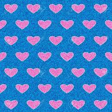 background stitch white stitch as a love symbol on blue jeans denim seamless