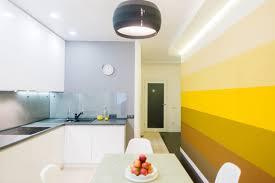modern yellow kitchen design creative gradient yellow kitchen accent wall design white