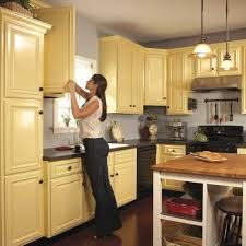 best paint to cover kitchen cabinets how to spray paint kitchen cabinets diy family handyman