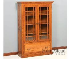 bookcase tall bookcase with glass doors and drawers alder wood