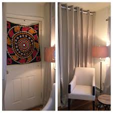 How To Cover A Window by Hide An Unwanted Door With A Tension Rod And Curtains That Match