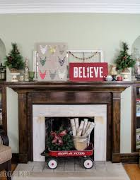 diy reindeer specimen art and my christmas mantel average but average but inspired s holiday mantel is filled with thrift store finds and diy art get