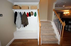 well groomed entryway bench coat rack beside stairs design with