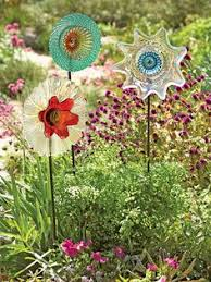 repurposed glass garden flower wall or garden made of vintage