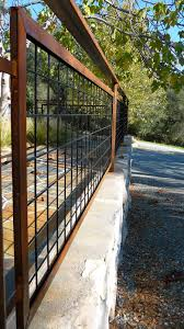 living iron hog wire fencing with patina landscape design