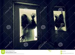 halloween monster window silhouettes horror woman in window wood hand hold cage scary scene halloween