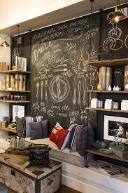 Retro Chalkboards For Kitchen by Plumbing Pipes Wood Shelves And A Wall Painted With Chalkboard