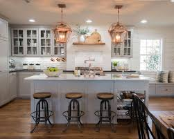 fixer upper copper accents gray cabinets and white marble