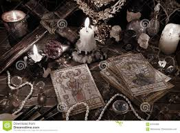 mystic ritual with tarot cards magic objects and candles in