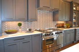 glass and metal kitchen backsplash with colorful kitchen design