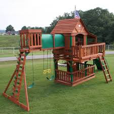 brown wood backyard playsets with epanse green grass for