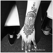 henna tattoo design with a cuff on the top of the hand from the