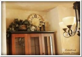 Decorate The Home Creative Juices Decor Decorating The Top Of Your Kitchen Cabinets