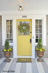 yellow front door 20 front porch makeovers front porches porch and mondays