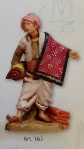 venditore di tappeti pastore venditore di tappeti realizzato in resina colorata e