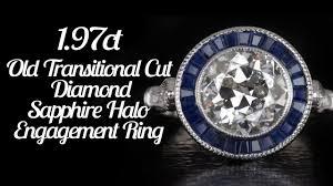 2 carat vintage round diamond calibre sapphire halo engagement