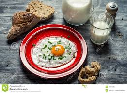 country style breakfast made up of eggs and bread royalty free