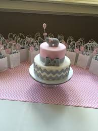 baby shower cake with elephant on top the cake is a pink rosette