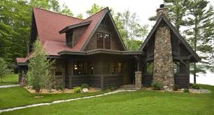 mountain style brown two story wood exterior home with a gable