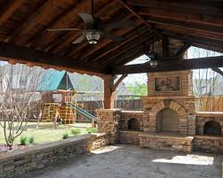 stone outdoor grill covered porch with fireplace patio with