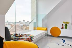 a budapest attic apartment designed with primary colors design milk