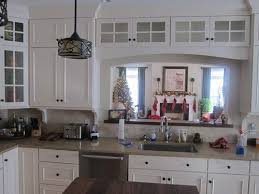 what to put on top of kitchen cabinets for decoration suggestions for what to put in the top glass cabinets
