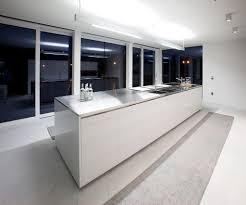 contemporary style kitchen with white long kitchen island single