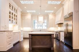 white kitchen with brown island transitional kitchen