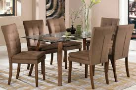 How To Make A Dining Room Table Photo Of A Glass Dining Table With A Wooden Chair Designcorner