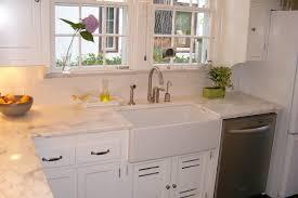 interior rectangek white sink on white wooden kitchen cabinet