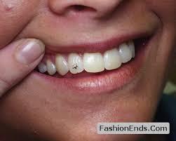 diamond stud on tooth tooth piercing with shining diamond