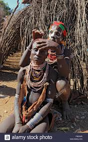 karo man ethiopia painting the face and body with colours releases