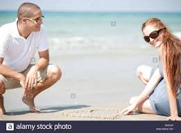 young loving couple siting on the beach stock photo royalty free