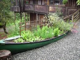 diy garden art repurpose old canoes into one of a kind gardens