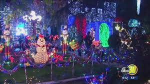 Red And White Christmas Lights Clovis Candy Cane Lane Lights Display Features Dead Deer Hanging