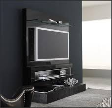 giant modern wall mounted tv shelves ideas with table lamp on the