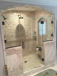 bathroom dark daltile wall with rain shower and frameless shower
