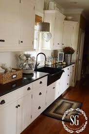 white sink black countertop fall house tour black sink black appliances and white cabinets