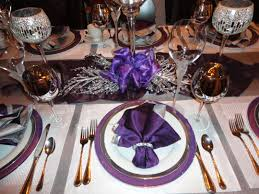 white and silver table runner purple charger white plate and purple napkin place setting silver