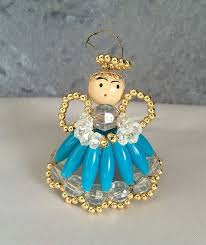 12 1960s vintage in a blue dress beaded ornament