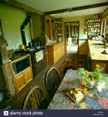 rayburn oven in old fashioned country kitchen with floral cloth on