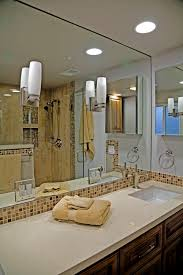 Bathroom Lighting Placement - enlarge a small bathroom by proper mirror placement