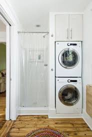 laundry room in bathroom ideas laundry stacked washed dryer in bathroom next to shower rock