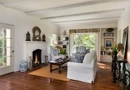 cottage living room with hardwood floors fireplace in